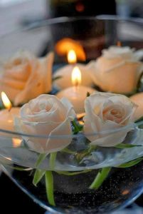 candle and roses b16de0f6ef86c3558c2156f210f76df9